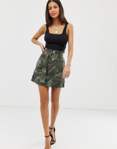 Minifalda con cintura paperbag en un estampado de camuflaje de River I...