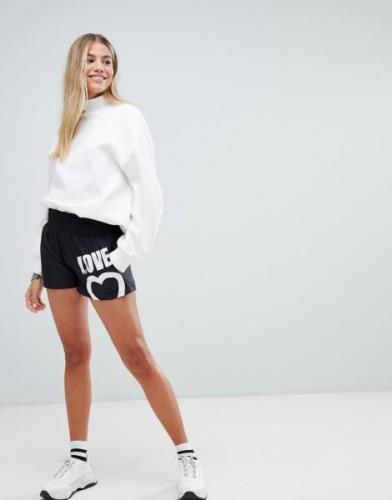 Pantalones cortos con logo gráfico de Love Moschino